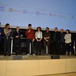 """Marco Bertozzi consegna il Premio UniCredit Pavilion al regista di """"Revelstoke. Un bacio nel vento"""" Nicola Moruzzi, sul palco insieme al Team del documentario, Francesco Bizzarri, Martina Colombari e Maurizio Beretta"""